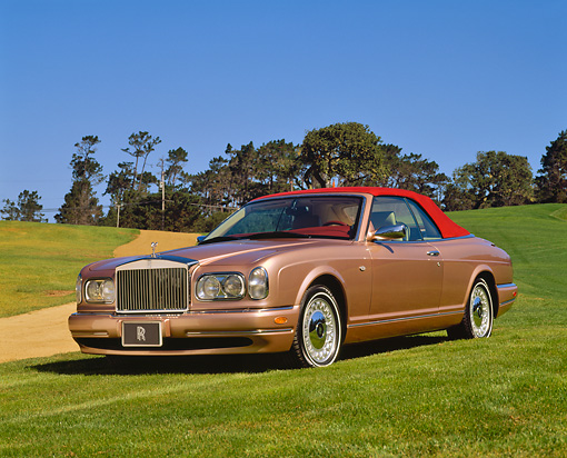 AUT 35 RK0399 01 © Kimball Stock 2002 Rolls-Royce Corniche Convertible Bronze 3/4 Front View On Grass