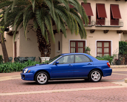 AUT 35 RK0063 01 © Kimball Stock 2002 Subaru WRX Impreza Blue Profile View By Spanish Building