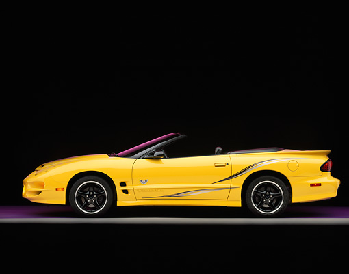 AUT 35 RK0066 05 © Kimball Stock 2002 Pontiac Firebird Trans Am Convertible Yellow Profile View On Gray Line Studio