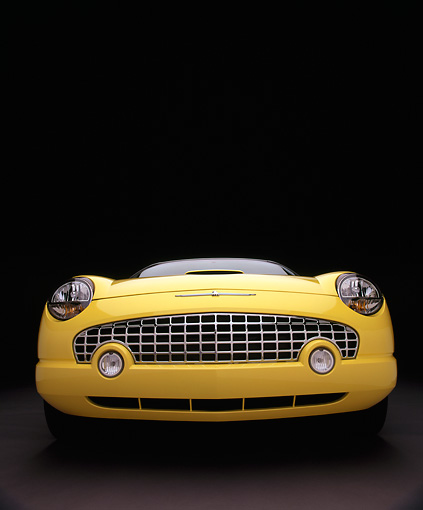 AUT 35 RK0105 09 © Kimball Stock 2002 Ford Thunderbird Convertible Yellow Wide Angle Head On Shot Studio