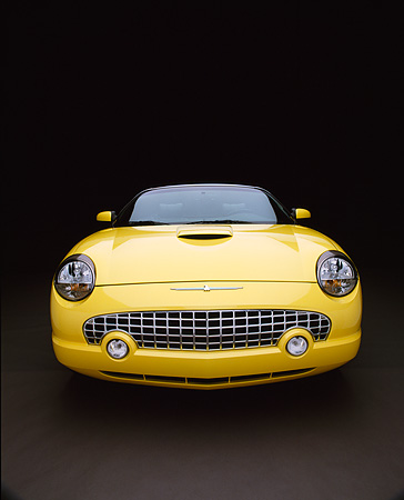 AUT 35 RK0106 07 © Kimball Stock 2002 Ford Thunderbird Convertible Yellow Head On Shot Studio
