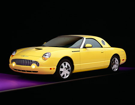 AUT 35 RK0107 02 © Kimball Stock 2002 Ford Thunderbird Convertible Yellow 3/4 Side View On Purple Floor Gray Line Studio