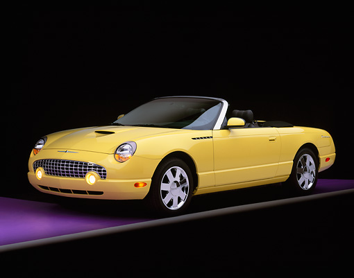 AUT 35 RK0109 04 © Kimball Stock 2002 Ford Thunderbird Convertible Yellow 3/4 Front View On Purple Floor Gray Line Studio