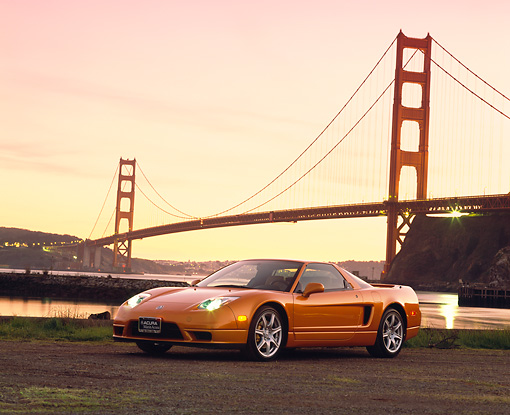 AUT 35 RK0156 02 © Kimball Stock 2002 Acura NSX Imola Orange Pearl 3/4 Front View On Dirt SF Bridge At Dusk