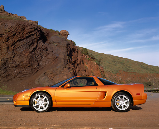 AUT 35 RK0159 04 © Kimball Stock 2002 Acura NSX Imola Orange Pearl Profile On Dirt By Rock Mountain Blue Sky
