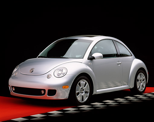 AUT 35 RK0161 03 © Kimball Stock 2002 Volkswagen New Beetle Turbo S Silver 3/4 Front View On Red Floor Checkered Line Studio