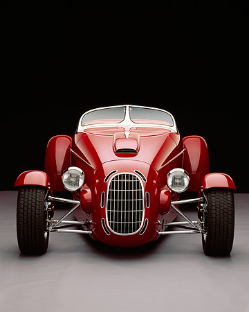 AUT 35 RK0190 02 © Kimball Stock 2002 Torpedo Roadster Custom Red Head On Shot Gray Floor Studio