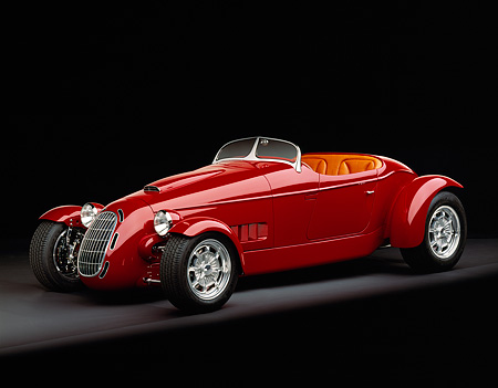 AUT 35 RK0192 06 © Kimball Stock 2002 Torpedo Roadster Custom Red 3/4 Side View On Gray Floor Studio