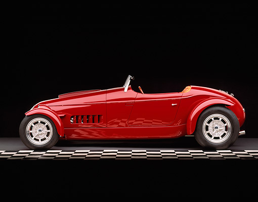 AUT 35 RK0193 05 © Kimball Stock 2002 Torpedo Roadster Custom Red Profile On Checkered Line Studio