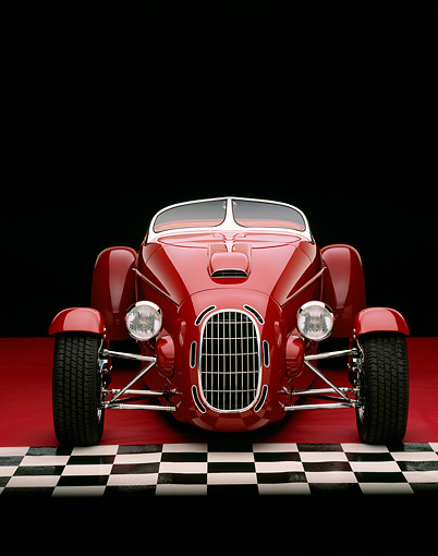 AUT 35 RK0194 04 © Kimball Stock 2002 Torpedo Roadster Custom Red Head On Shot On Red And Checkered Floor Studio