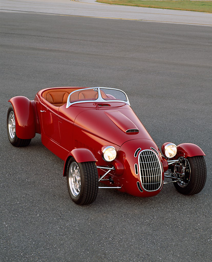 AUT 35 RK0203 02 © Kimball Stock 2002 Torpedo Roadster Custom Red 3/4 Front View On Pavement