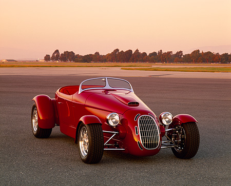 AUT 35 RK0207 06 © Kimball Stock 2002 Torpedo Roadster Custom Red 3/4 Front View On Pavement Filtered