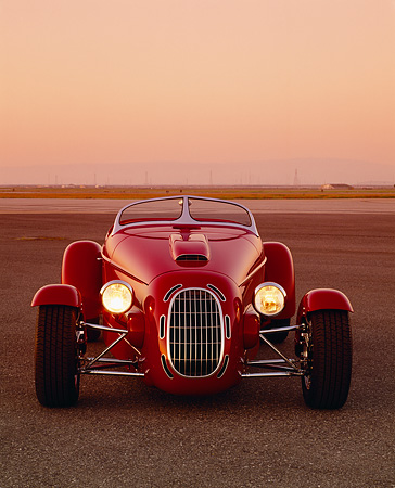 AUT 35 RK0209 04 © Kimball Stock 2002 Torpedo Roadster Custom Red Head On Shot On Pavement Filtered