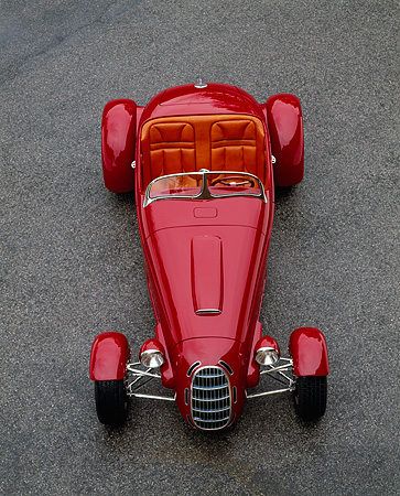 AUT 35 RK0211 04 © Kimball Stock 2002 Torpedo Roadster Custom Red Overhead Head On Shot On Pavement