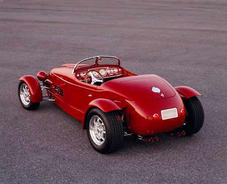 AUT 35 RK0216 01 © Kimball Stock 2002 Torpedo Roadster Custom Red 3/4 Rear View On Pavement
