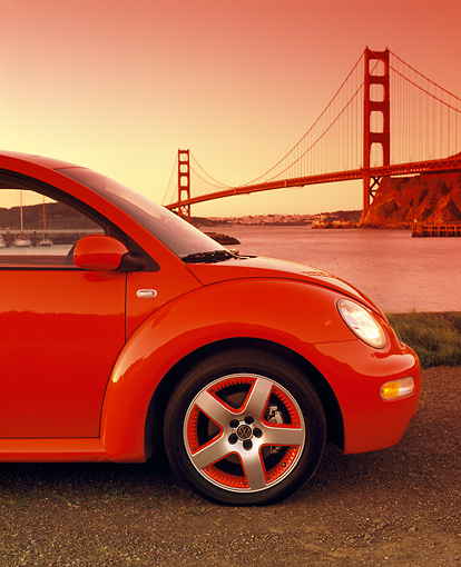 AUT 35 RK0245 03 © Kimball Stock Close Up 2002 VW New Beetle GLS Turbo Orange Profile By Golden Gate Bridge Filtered