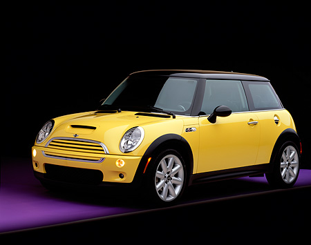 AUT 35 RK0297 07 © Kimball Stock 2002 Mini Cooper S Yellow And Black 3/4 Front View On Purple Floor Gray Line Studio