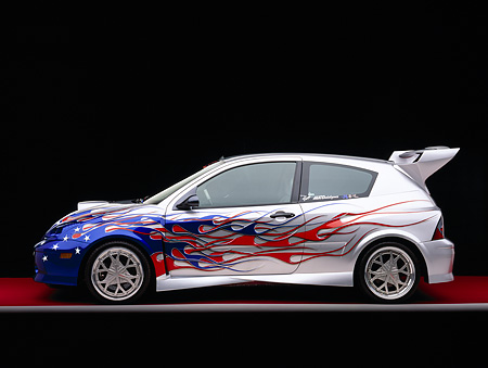 AUT 35 RK0323 06 © Kimball Stock 2002 Ford Focus FR200 Turbo Modified By APC Silver Patriotic Graphics Profile Featured In Fast & Furious 2