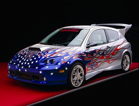 AUT 35 RK0324 03 © Kimball Stock 2002 Ford Focus FR200 Turbo Modify By APC Silver Patriotic Graphics 3/4 Front View Featured In Fast & Furious 2