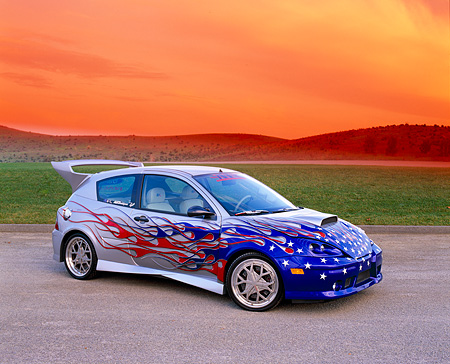 AUT 35 RK0327 04 © Kimball Stock 2002 Ford Focus FR200 Turbo Silver Patriotic Graphics Modify By APC 3/4 Side On Gravel Filtered In Fast & Furious 2