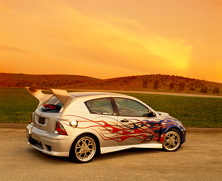 AUT 35 RK0329 05 © Kimball Stock 2002 Ford Focus FR200 Turbo Silver Patriotic Modify By APC 3/4 Rear View On Gravel Grass Hill In Fast & Furious 2