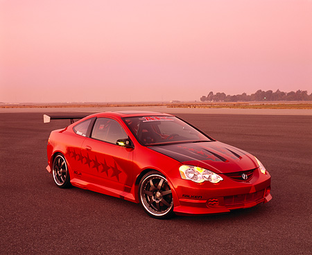 AUT 35 RK0340 04 © Kimball Stock 2002 Acura RSX Type S Red With Graphics Modify By APC Front 3/4 View On Pavement Filtered