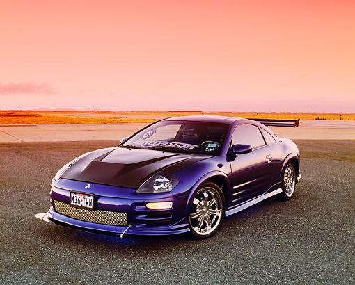AUT 35 RK0380 01 © Kimball Stock 2002 Mitsubishi Eclipse Violet Blue 3/4 Front View On Pavement Filtered