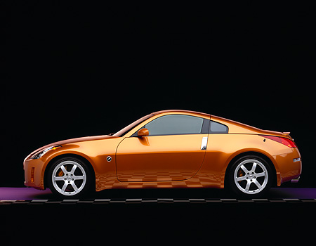 AUT 38 RK0050 06 © Kimball Stock 2003 Nissan 350Z Orange Profile On Purple Floor Checkered Line Studio