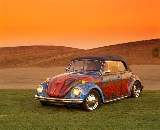 AUT 36 RK0044 04 © Kimball Stock 1972 VW Bug Art Car 3/4 Front View On Grass Hills Yellow Sky