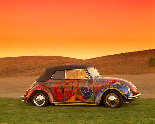 AUT 36 RK0045 02 © Kimball Stock 1972 Volkswagen Beetle Convertible Art Car 3/4 Front View On Grass Hills Filtered