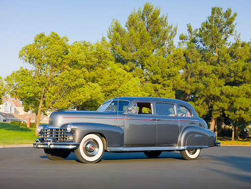 AUT 37 RK0031 01 © Kimball Stock 1949 Cadillac 75 Imperial Limousine Gray 3/4 Front View On Pavement By Trees