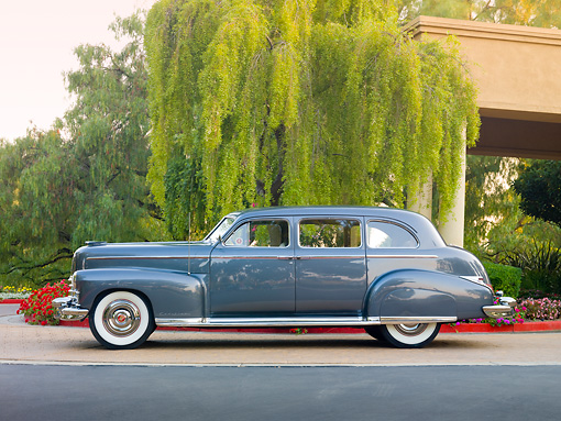 AUT 37 RK0033 01 © Kimball Stock 1949 Cadillac 75 Imperial Limousine Gray Profile View On Pavement By Trees And Building