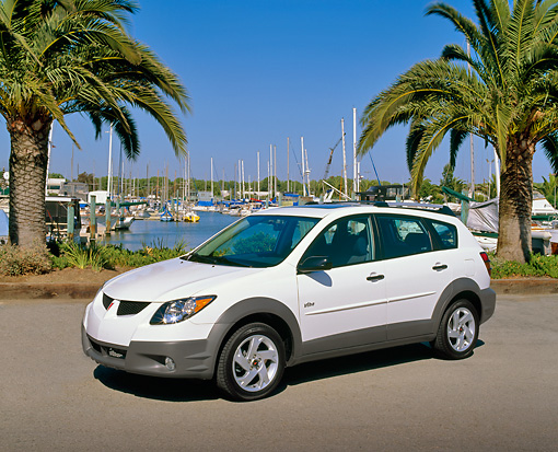 AUT 38 RK0013 01 © Kimball Stock 2003 Pontiac Vibe White 3/4 Side View On Pavement By Harbor