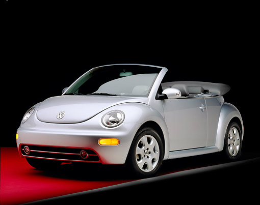 AUT 38 RK0098 05 © Kimball Stock 2003 VW New Beetle Convertible Silver Low 3/4 Front View On Red Floor Gray Line Studio
