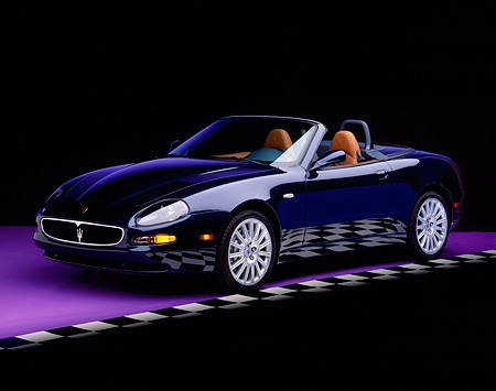 AUT 38 RK0002 05 © Kimball Stock 2003 Maserati Spyder Blue Front 3/4 View On Purple Floor Checkered Line Studio