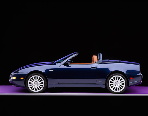 AUT 38 RK0003 11 © Kimball Stock 2003 Maserati Spyder Blue Profile On Purple Floor Gray Line Studio