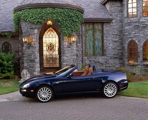 AUT 38 RK0007 08 © Kimball Stock 2003 Maserati Spyder Blue Profile In Front Of House On Driveway
