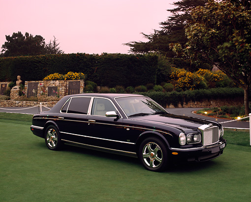 AUT 38 RK0029 02 © Kimball Stock 2003 Bentley Arnage R Black Side 3/4 View On Grass By Trees And Bushes