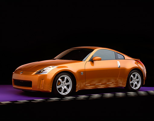 AUT 38 RK0031 03 © Kimball Stock 2003 Nissan 350Z Le Mans Sunset 3/4 Side View On Purple Floor Gray Line Studio
