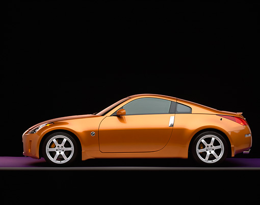 AUT 38 RK0032 02 © Kimball Stock 2003 Nissan 350Z Orange Profile View On Purple Floor Gray Line Studio