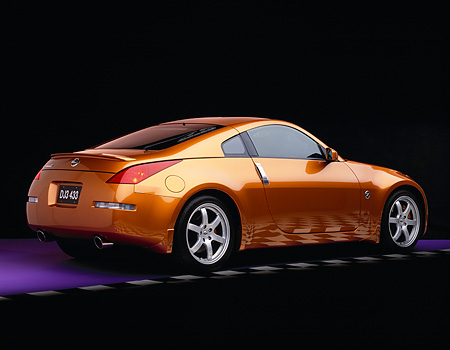AUT 38 RK0033 05 © Kimball Stock 2003 Nissan 350Z Le Mans Sunset 3/4 Rear View On Purple Floor Checkered Line Studio