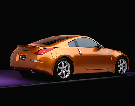 AUT 38 RK0034 06 © Kimball Stock 2003 Nissan 350Z Le Mans Sunset 3/4 Rear View On Purple Floor Gray Line Studio