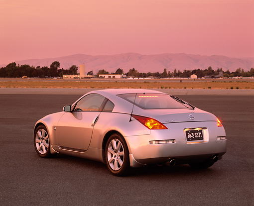 AUT 38 RK0041 04 © Kimball Stock 2003 Nissan 350Z Silver 3/4 Rear View On Pavement Filtered