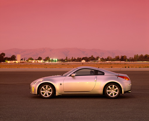AUT 38 RK0045 01 © Kimball Stock 2003 Nissan 350Z Silver Profile On Pavement Red Filter