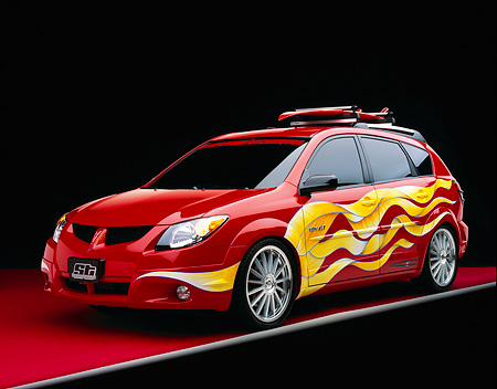 AUT 38 RK0101 03 © Kimball Stock 2003 Pontiac Vibe GT Red Yellow Graphics Surfboard Suspension Techniques 3/4 Front Red Floor Gray Line