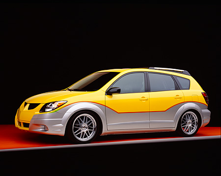 AUT 38 RK0113 05 © Kimball Stock 2003 Pontiac Vibe Yellow And Silver Super Charged Suspension Techniques 3/4 Side Orange Floor Gray Line