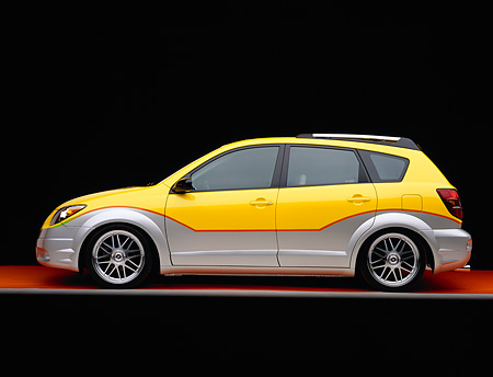 AUT 38 RK0114 04 © Kimball Stock 2003 Pontiac Vibe Yellow And Silver Super Charged Suspension Techniques Side View Orange Floor Gray Line