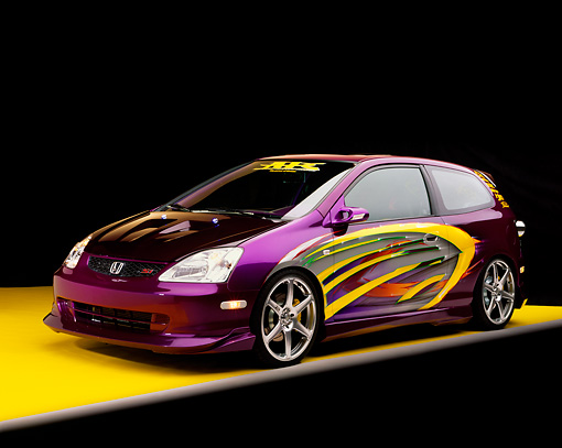 AUT 38 RK0122 06 © Kimball Stock 2003 Honda Civic Si Purple With Graphics Modify By APC Front 3/4 View On Yellow Floor Gray Line Studio