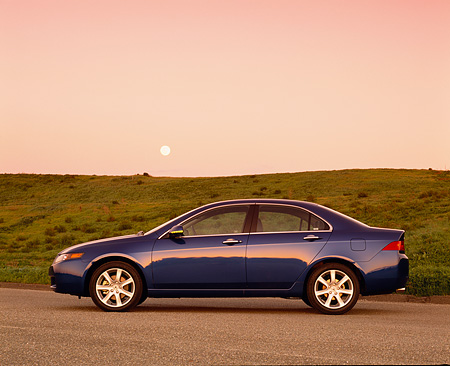 AUT 38 RK0153 06 © Kimball Stock 2003 Acura TSX Blue Profile On Pavement By Grass Hill Filtered