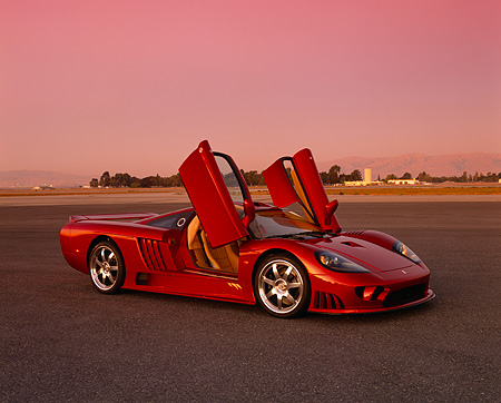 AUT 38 RK0200 02 © Kimball Stock 2003 Saleen S7 Red 3/4 Side View On Pavement Doors Open Filtered